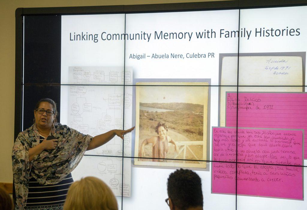 Photo of Mirerza González-Vélez presenting at NEH 2019 Summer Institute